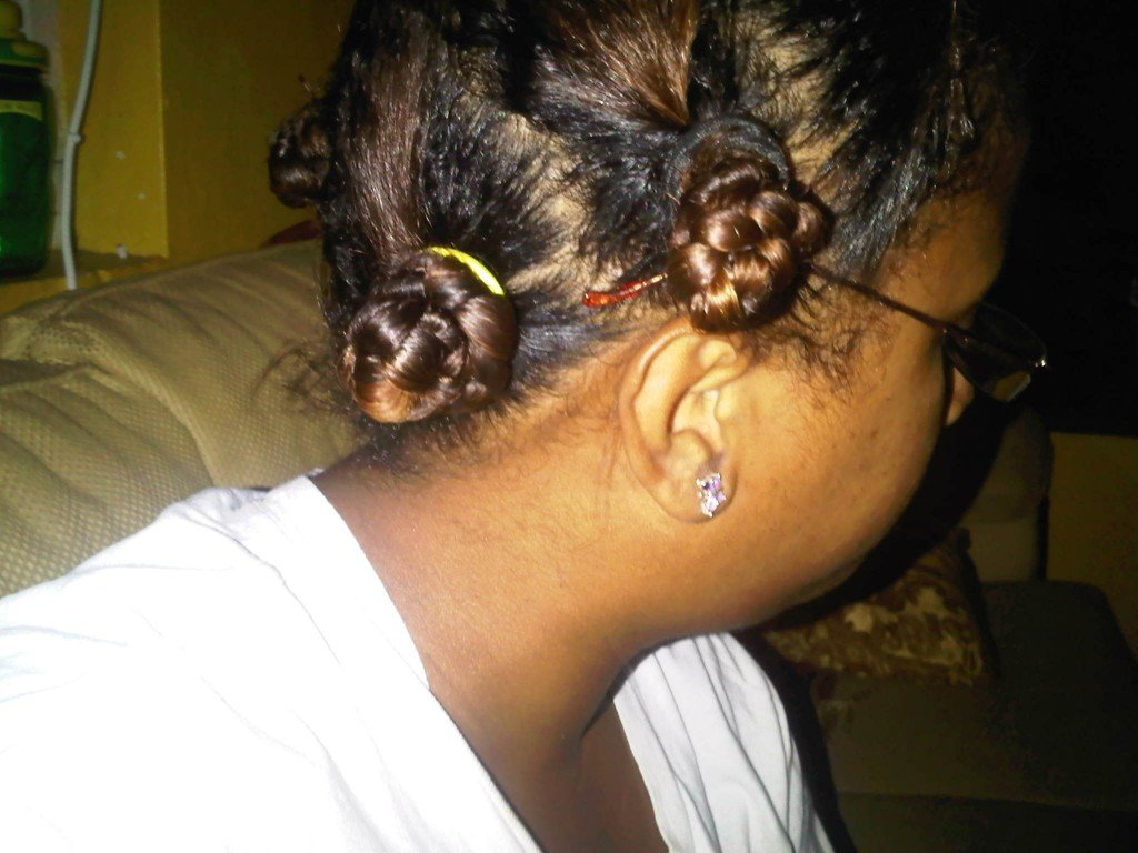 Relaxed, transitioning hair in braided bantu knots