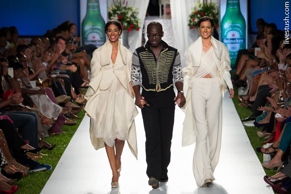 Miss Jamaica Universe 2010 Yendi Phillipps (left) and Miss Jamaica Universe 2013 Kerrie Baylis (right) wear designs from Sukeina Fashion Line while walking with designer Omar Salaam at the closing of the 2013