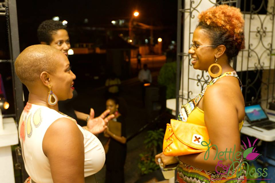 IrieDiva speaking with Felicia Leatherwood as Aisha Morgan, owner of Nettle and Moss looks on
