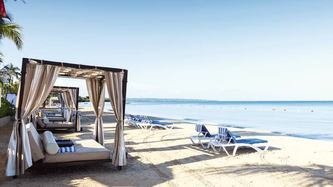 Beach cabanas at Sensatori Negril, styled by Jonathan Saunders